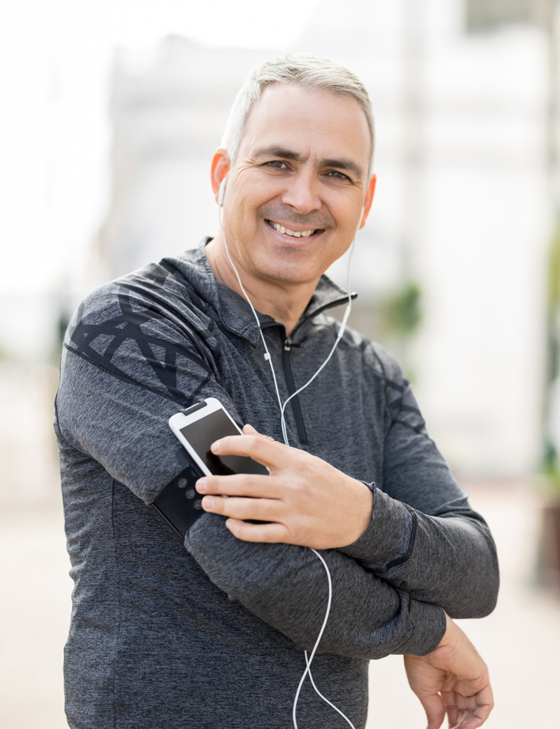 Man running with phone, middle aged